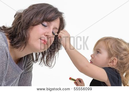 Little Girl Applying Makeup To Her Mother