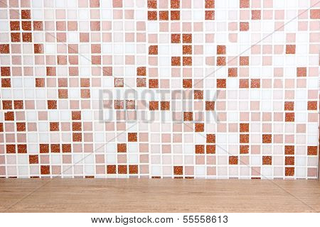 Table and mosaic tiles in kitchen close-up background