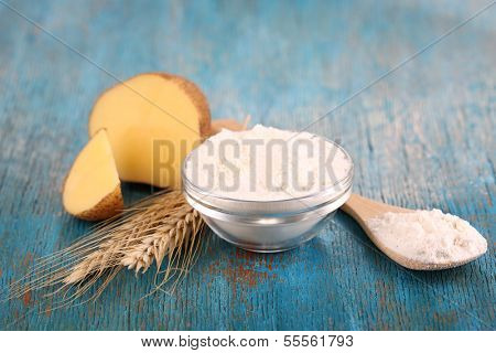 Starch in bowl on wooden table close-up
