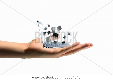 Pile of laptops in human hand. Technology concept
