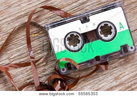 Retro Audio Cassette  On The Wood Background