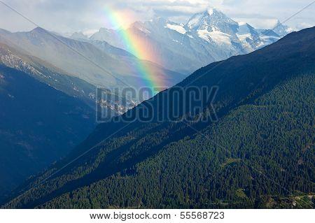 Rainbow Over The Alps.