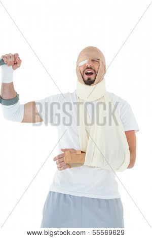Cheerful young man with broken hand cheering over  white background