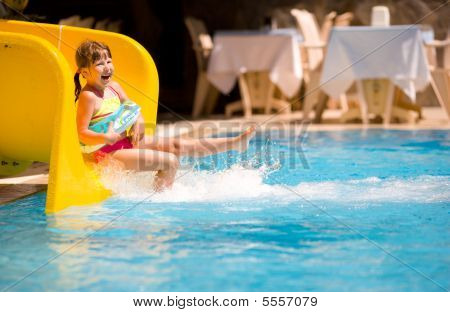 Girl Sliding In Pool