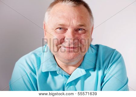 Close up portrait of middle aged smiling man on white background
