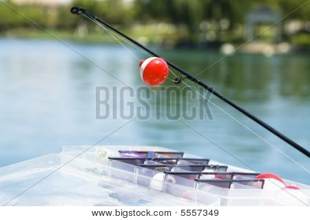 Fishing Rod Hanging Over The Water.