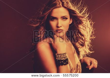 sensual woman with hair in motion retro colors studio shot