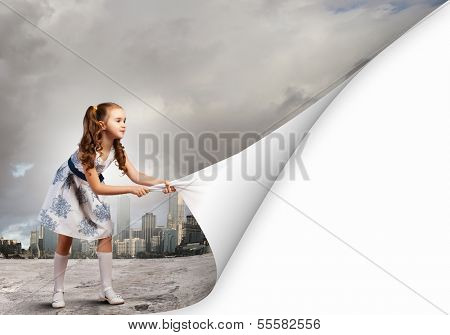 Little girl turning page with another reality