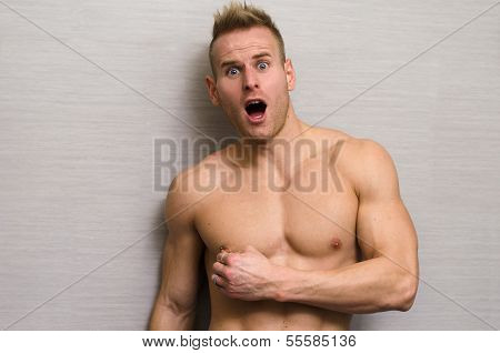 Muscular Male In Pain, Pulling Nipple Piercing With His Hand