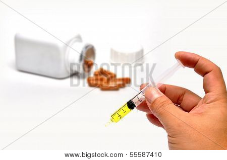 Human Hand With Injection Syringe