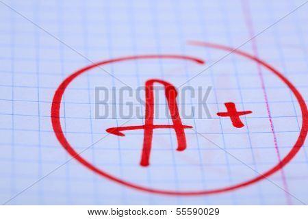 Grade A+ written on an exam paper
