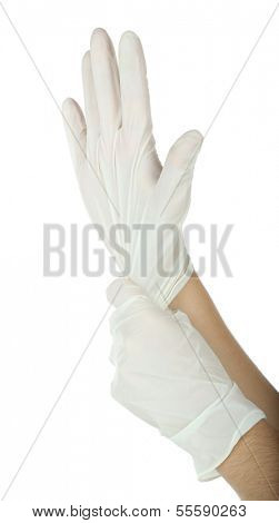 Doctor putting on protective gloves, isolated on white