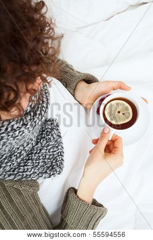 Ill Woman With Cup Of Tea