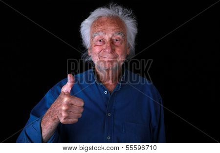 Portrait of a Senior Man with Thumbs Up for Support on Black Background