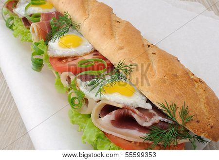 Big Sandwich With Ham, Tomato And Quail Egg