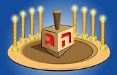 hanukkah candles with traditional top toy
