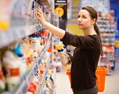 stock photo of supermarket  - Beautiful young woman shopping for cereal bulk in a grocery supermarket - JPG