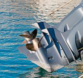 image of outboard engine  - boat engine propellers over yhe blue water - JPG