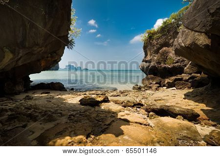 Tropical Beach View From Karst Limestone Cave. Ocean Landscape Under Blue Sky Af Pranang Cave Beach,