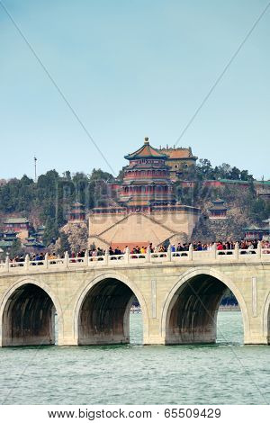 BEIJING, CHINA - APR 5: Summer Palace with bridge over lake on April 5, 2013 in Beijing, China. It was formerly imperial palace and now is the World Heritage Site in Beijing.