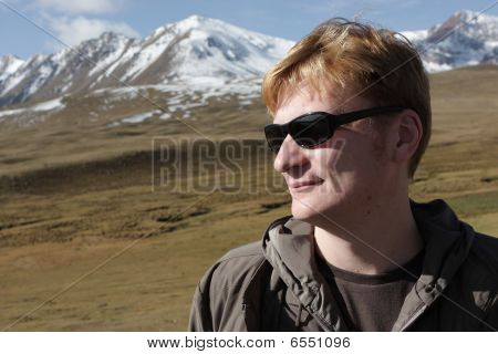 Tourist In Mountains