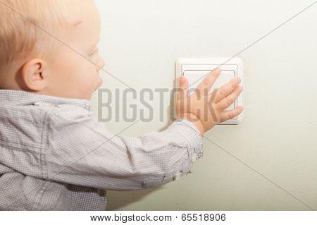 Baby Boy Child Kid Turning On The Light.