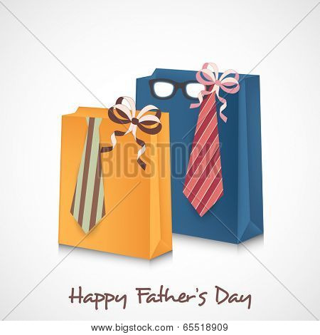 Happy Father's Day celebrations concept with colourful shopping bags and necktie wrapped by ribbon.