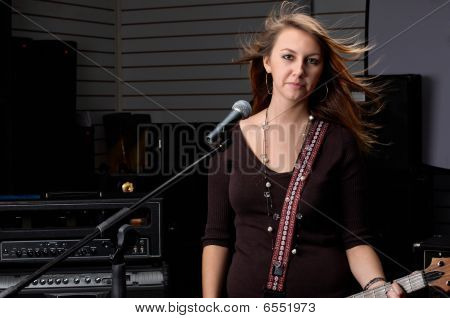 Girl With Guitar Amd Microphone