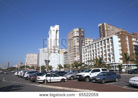 Parked Motor Vehicles And Buildings On Beachfront