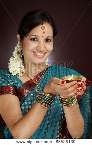 Portrait Of Beautiful Traditional Woman Holding Oil Lamp Light