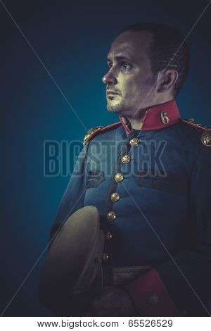 Retro general of the Spanish army, blue coat and gold epaulettes