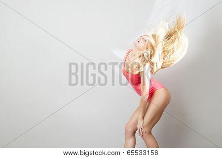 Portrait Of A Woman In Red Bodysuit