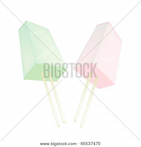 Two Flavored Popsicle Ice Creams On White Background