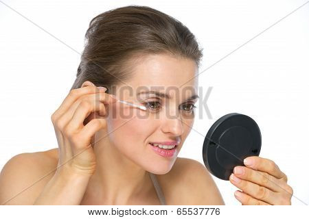 Young Woman Using Cotton Swabs