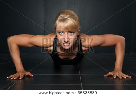 Beautiful Athletic Woman Is Pushed Up