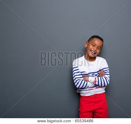 Cute Little Boy Smiling With Arms Crossed