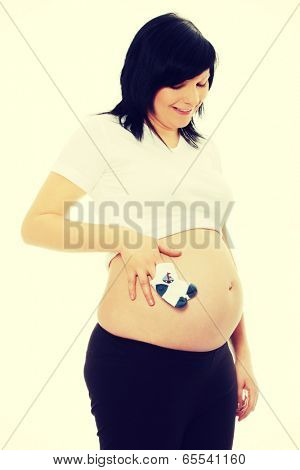 Pregnant woman with baby socks