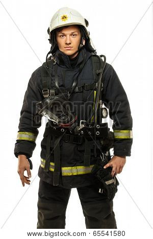Young firefighter wearing helmet isolated on white