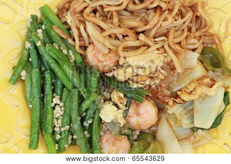 Chinese dinner with long beans,chow mein and shrimp