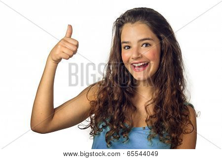 Beautiful teenage girl smiling and doing the thumbs-up sign