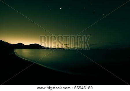 Night Shot Of Sea. Toned.