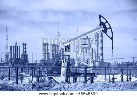 Pump Jack And Oil Refinery. Toned.