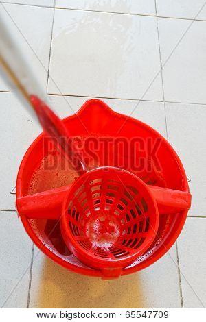 Mop In Red Bucket With Foamy Water