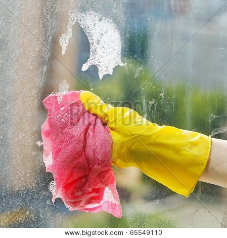 Cleaning Window Glass By Soap Suds Water