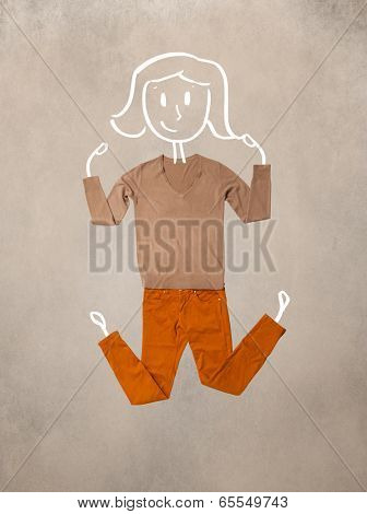 Colorful placed clothes in different actions with woman drawing