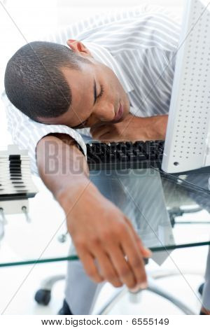Tired businessman sleeping on his desk