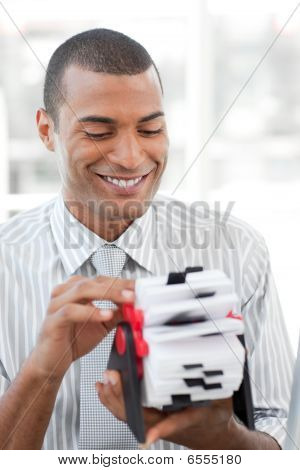 Attractive Businessman Consulting A Business Card Holder