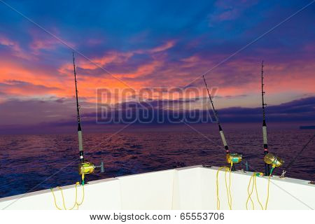 boat fishing trolling at sunset big game with rods and reels in saltwater