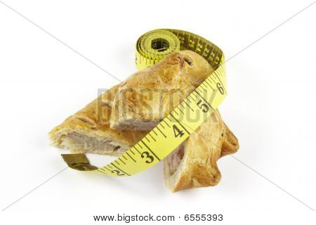Sausage Roll With Pork Pie And Tape Measure