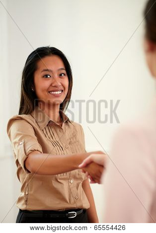 Charming Asiatic Woman Giving Hands Greeting